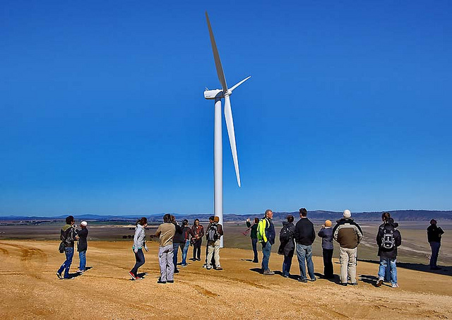 All of John McCarthy's class looking at the large wind turbines.